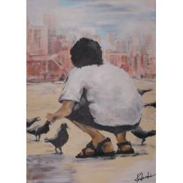 chłopczyk karmiący ptaki